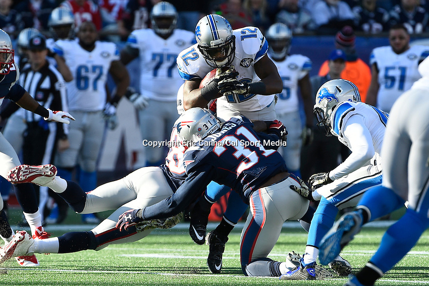 November 23, 2014 - Foxborough, Massachusetts, U.S.- Detroit Lions wide receiver Jeremy Ross (12) tries to work trough tackles during the NFL game between the Detroit Lions and the New England Patriots held at Gillette Stadium in Foxborough Massachusetts. The Patriots defeated the Lions 34-9. Eric Canha/CSM