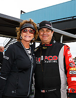 Oct 15, 2017; Ennis, TX, USA; NHRA top fuel driver Billy Torrence (right) and wife Kay Torrence during the Fall Nationals at the Texas Motorplex. Mandatory Credit: Mark J. Rebilas-USA TODAY Sports