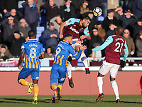 West Ham United's Winston Reid and Shrewsbury Town's Carlton Morris<br /> <br /> Photographer Rob Newell/CameraSport<br /> <br /> The Emirates FA Cup Third Round - Shrewsbury Town v West Ham United - Sunday 7th January 2018 - New Meadow - Shrewsbury<br />  <br /> World Copyright &copy; 2018 CameraSport. All rights reserved. 43 Linden Ave. Countesthorpe. Leicester. England. LE8 5PG - Tel: +44 (0) 116 277 4147 - admin@camerasport.com - www.camerasport.com