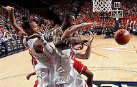 Virginia guard Joe Harris (12) is fouled by North Carolina State forward C.J. Leslie (5) during the game Saturday in Charlottesville, VA. Virginia defeated NC State 58-55.