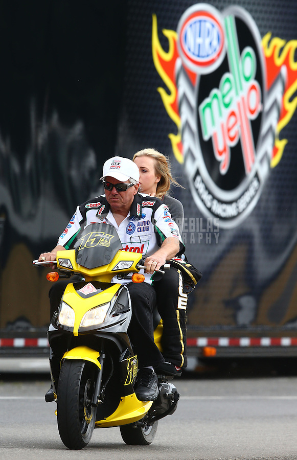 Aug. 3, 2013; Kent, WA, USA: NHRA funny car driver John Force with daughter Brittany Force during qualifying for the Northwest Nationals at Pacific Raceways. Mandatory Credit: Mark J. Rebilas-USA TODAY Sports