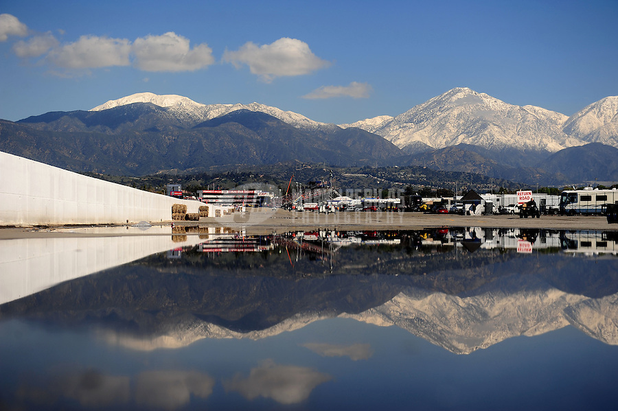 Feb. 27, 2011; Pomona, CA, USA; Auto Club Raceway at Pomona reflects in a rain puddle prior to the start of eliminations for the NHRA Winternationals. Mandatory Credit: Mark J. Rebilas-