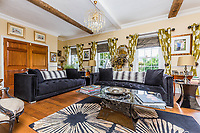 BNPS.co.uk (01202 558833)<br /> Pic: Rightmove/BNPS<br /> <br /> Another one of the sitting rooms...<br /> <br /> A period property halfway up one of England's steepest hills is not a home for the faint-hearted.<br /> <br /> The buyer of this house - on the market for £975,000 - will need to be an energetic fitness fan to face the tough slog up the aptly named Steep Hill; the fourth steepest street in the country.<br /> <br /> The Grade II Listed townhouse is on Christs Hospital Terrace in Lincoln, a quaint cobbled street that branches off Steep Hill.<br /> <br /> The road has an unusually severe 16.12-degree gradient, making it one of the steepest residential streets in England, according to the Ordnance Survey.