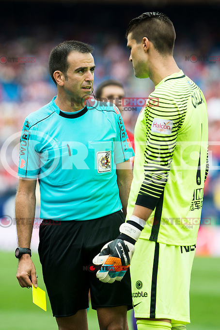 Referee talking with Atletico de Madrid's player Iván Cuéllar and Sporting de Gijon's XXX during a match of La Liga Santander at Vicente Calderon Stadium in Madrid. September 17, Spain. 2016. (ALTERPHOTOS/BorjaB.Hojas) /NORTEPHOTO