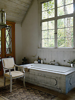 The bath is designed to feel like a trough in an old barn with the tap coming straight out of the wall and was a gift from Jill's husband