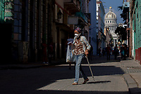 HAVANA, CUBA - MARCH 25: A woman wears a face mask  to prevent the spread of COVID-19 in Old Havana, on March 25, 2020. The World Health Organization declared a global pandemic as the coronavirus rapidly spreads across the world.(Photo by Eliana Aponte/VIEWpress/Corbis via Getty Images)