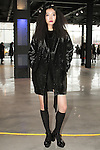 Jisu (Marilyn Agency) poses in an outfit from the Saunder Fall Winter 2016 collection by Emily Saunders during New York Fashion Week Fall 2016.