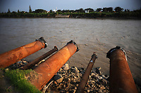 Pipes used to pump mud into the Porong River. Since May 2006, more than 10,000 people in the Porong subdistrict of Sidoarjo have been displaced by hot mud flowing from a natural gas well that was being drilled by the oil company Lapindo Brantas. The torrent of mud - up to 125,000 cubic metres per day - continued to flow three years later.