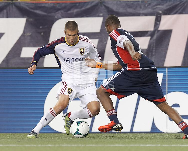 Real Salt Lake defender Chris Wingert (17) dribbles as New England Revolution defender Andrew Farrell (2) closes.