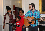 Designer Tracy Reese and Actress and singer Rhonda Ross (Another World) and son Raif sing Christmas Carols - Hearts of Gold links to a better life celebrates Christmas with a party #2 for mothers and their children on December 17, 2016 in New York City, New York with arts and crafts, a great turkey dinner with all the goodies and then the children met Santa Claus and had a photo with him as he gave them gifts. (Photo by Sue Coflin/Max Photos)