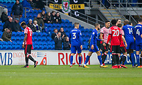 Didier Ndong of Sunderland (far left) leaves the field after being shown a red card during the Sky Bet Championship match between Cardiff City and Sunderland at the Cardiff City Stadium, Cardiff, Wales on 13 January 2018. Photo by Mark  Hawkins / PRiME Media Images.