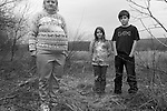 A Grandmother and her Grandchildren standing in a field in the country