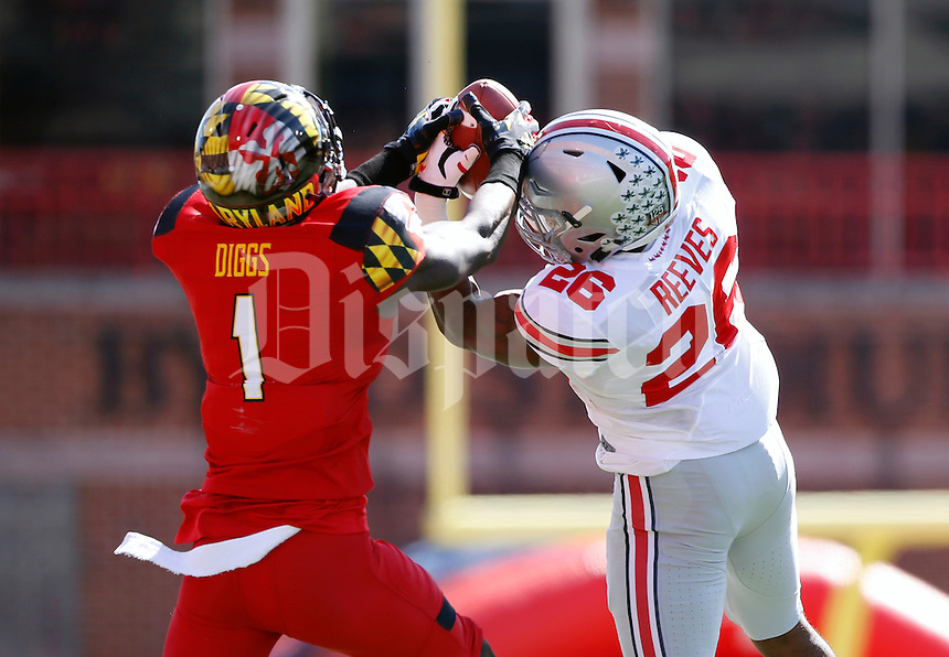 Ohio State Buckeyes cornerback Armani Reeves (26) breaks up a pass intended for Maryland Terrapins wide receiver Stefon Diggs (1) during the second quarter of the NCAA football game at Byrd Stadium in College Park, Maryland on Oct. 4, 2014. (Adam Cairns / The Columbus Dispatch)