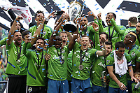 SEATTLE, WA - NOVEMBER 10: Nouhou #5 of the Seattle Sounders FC raises the Philip F. Anschutz trophy while celebrating with his teammates during a game between Toronto FC and Seattle Sounders FC at CenturyLink Field on November 10, 2019 in Seattle, Washington.