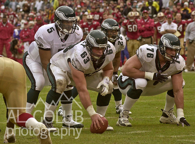 Philadelphia Eagles quarterback Donovan McNabb (5) lines up with center Hank Fraley (63) and guard John Welbourn (76) on Saturday, December 22, 2001, in San Francisco, California. The 49ers defeated the Eagles 13-3.