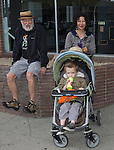 Waylon with grandparents Keith and Lupita watch the Reno Rodeo Parade held in Midtown on Virginia Street on Saturday, June 18, 2016.