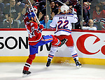 23 January 2010: New York Rangers' center Brian Boyle gets a kick in the pants by Montreal Canadiens defenseman Hal Gill during a game at the Bell Centre in Montreal, Quebec, Canada. The Canadiens shut out the Rangers 6-0. Mandatory Credit: Ed Wolfstein Photo
