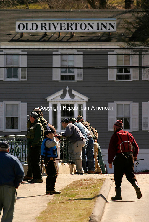 RIVERTON, CT- 16 APRIL 2005-041605JS11--Fishermen and spectators line the bridge in front of the Old Riverton Inn in Riverton Saturday for the opening of Trout season.  --- Jim Shannon Photo--Farmington River; Riverton; Old Riverton Inn are CQ