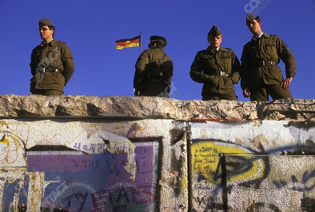 Opening of the Berlin Wall. East German troops atop the wall, near the Brandenburg Gate. West Berlin, Germany, November 1989.