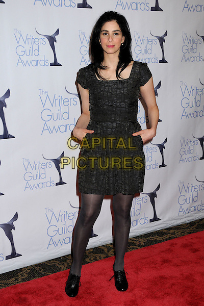 SARAH SILVERMAN .WGA 2009 Writers Guild Awards at the Hyatt Regency Century Plaza Hotel, Century City, CA, USA, .07 February 2009. .full length black dress hands in pockets lace-up shoes booties .CAP/ADM/BP.©Byron Purvis/Admedia/Capital PIctures