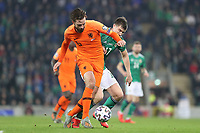 16th November 2019; Windsor Park, Belfast, County Antrim, Northern Ireland; European Championships 2020 Qualifier, Northern Ireland versus Netherlands; Northern Ireland's Paddy McNair challenges Davy Propper of Netherlands for the ball - Editorial Use