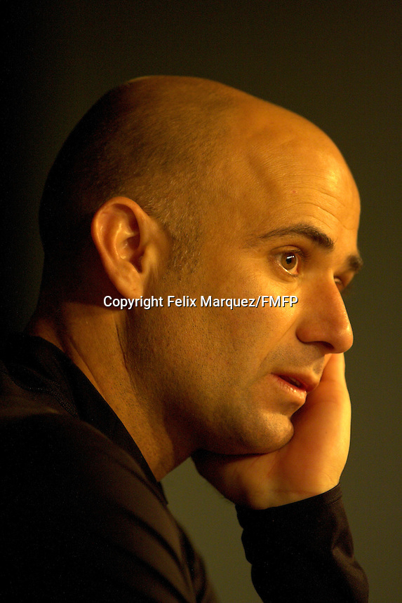 Andre Agassi of the USA speaks to the press prior to the start of the 2006 Pacific Life Open at Indian Wells Garden, Indian Wells, CA