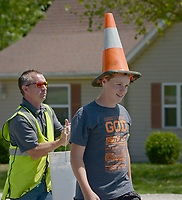 NWA Democrat-Gazette/BEN GOFF @NWABENGOFF<br /> Students from the Pea Ridge Middle School 8th grade elective art class paint their design Monday, May 15, 2017, as Pea Ridge Mayor Jackie Crabtree stops by to take a look, along Weston Street in front of the school in Pea Ridge. Students in the class partnered with UpStream Art to learn about water quality issues before working in small groups to designs and paint murals on six storm drains near the school.