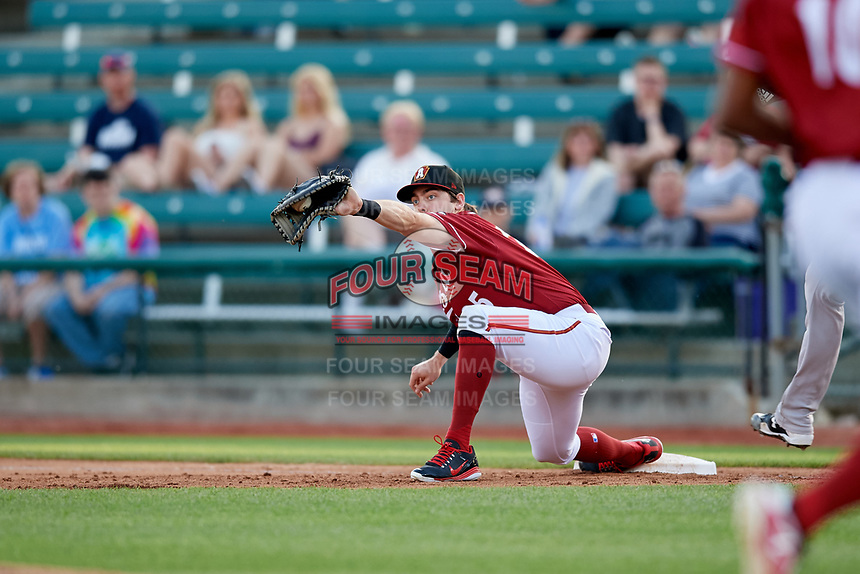 Altoona Curve first baseman Will Craig (25) stretches to receive a throw during a game against the Richmond Flying Squirrels on May 15, 2018 at Peoples Natural Gas Field in Altoona, Pennsylvania.  Altoona defeated Richmond 5-1.  (Mike Janes/Four Seam Images)