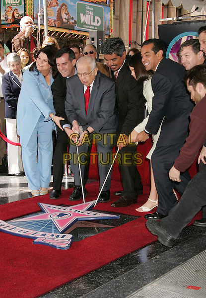 ANN LOPEZ, ERIC GARCETTI, JOHNNY GRANT, GEORGE LOPEZ, MATAM LOPEZ, L.A. MAYOR ANTONIA VILLARAIGOSA, LERON GUBLER & PETER ROTH.George Lopez Star on The Hollywood Walk Of Fame, Hollywood, California, USA..March 29th, 2006.Photo: Russ Elliot/AdMedia/Capital Pictures.Ref: RE/ADM.full length grey gray black blue suit daughter wife husband father married lifting.www.capitalpictures.com.sales@capitalpictures.com.© Capital Pictures.