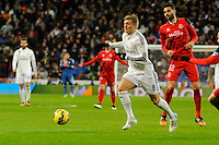 Real Madrid´s Toni Kroos and Sevilla's Vicente Iborra during 2014-15 La Liga match between Real Madrid and Sevilla at Santiago Bernabeu stadium in Alcorcon, Madrid, Spain. February 04, 2015. (ALTERPHOTOS/Luis Fernandez) /NORTEphoto.com