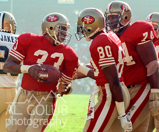 San Francisco 49ers vs New Orleans Saints at Candlestick Park Sunday, December 11, 1988..49ers beat Saints 30-17.San Francisco 49er running back Roger Craig (33) and receiver Jerry Rice (80) celebrate touchdown...