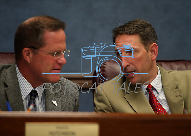 Nevada Senators Mark Hutchison, left, and Scott Hammond, both R-Las Vegas, work in committee at the Nevada Legislature in Carson City, Nev., on Monday, March 4, 2013..Photo by Cathleen Allison