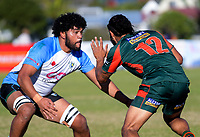 Grammar's Taniela Matakaiongo tries to stop William Rew (right) during the Auckland Premier club rugby Alan McEvoy Trophy match between Pakuranga and Grammar TEC at Bell Park in Auckland, New Zealand on Saturday, 9 June 2018. Photo: Dave Lintott / lintottphoto.co.nz