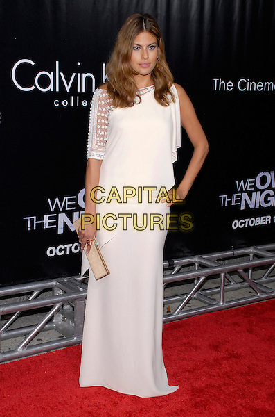 "EVA MENDES.The New York premiere of ""We Own the Night"" held at Clearview Chelsea West, New York, New York, USA,.09 October 2007..full length long white dress gold ring hand on hip clutch bag.CAP/ADM/BL.©Bill Lyons/AdMedia/Capital Pictures. *** Local Caption ***"
