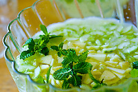Close-up of a bowl of pineapple lemonade with mint