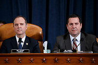 Democratic Chairman of the House Permanent Select Committee on Intelligence Adam Schiff (L) and Ranking member of the House Permanent Select Committee on Intelligence Devin Nunes (R) during the House Permanent Select Committee on Intelligence public hearing on the impeachment inquiry into US President Donald J. Trump, on Capitol Hill in Washington, DC, USA, 19 November 2019. The impeachment inquiry is being led by three congressional committees and was launched following a whistleblower's complaint that alleges US President Donald J. Trump requested help from the President of Ukraine to investigate a political rival, Joe Biden and his son Hunter Biden.<br /> Credit: Shawn Thew / Pool via CNP/AdMedia