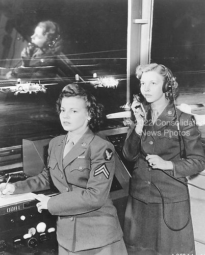 Women's Army Corps, Randolph Field, Texas, 1944.  Over 150,000 American women served in the Women's Army Corps (WAC) during World War 2.  Members of the WAC were the first women other than nurses to serve within the ranks of the United States Army.  Both the Army and the American public initially had difficulty accepting the concept of women in uniform. However, political and military leaders, faced with fighting a two-front war and supplying men and materiel for that war while continuing to send lend-lease material to the Allies, realized that women could supply the additional resources so desperately needed in the military and industrial sectors. Given the opportunity to make a major contribution to the national war effort, women seized it. By the end of the war their contributions would be widely heralded. .Credit: U.S. Air Force via CNP
