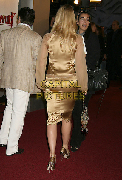"NICOLLETTE SHERIDAN.""Beowulf"" Los Angeles Premiere held at Mann's Village Theatre, Westwood, California, USA..November 5th, 2007.full length Nicolette gold dress silk satin sheer sleeves bag shoes beige back behind rear .CAP/ADM/RE.©Russ Elliot/AdMedia/Capital Pictures."