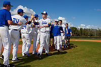 South Dakota State Jackrabbits Tyler Olmstead (28) high fives teammates after a game against the FIU Panthers on February 23, 2019 at North Charlotte Regional Park in Port Charlotte, Florida.  South Dakota State defeated FIU 4-3.  (Mike Janes/Four Seam Images)