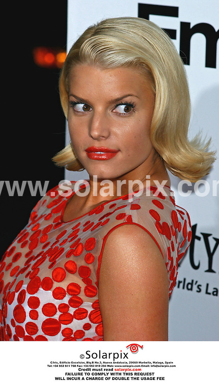 ALL ROUND PICTURES BY SOLARPIX.COM.**MUST CREDIT SOLARPIX.COM OR DOUBLE FEE WILL BE CHARGED**.*NOT FOR SYNDICATION IN THE USA AND FRANCE*.Jessica Simpson arrives at the premiere of her film 'EMPLOYEE OF THE MONTH' at the Grauman's Chinese Theatre in Los Angeles in California on 19_09_06 in the USA...DATE:20_09_06-JOB REF:2823-GLS.