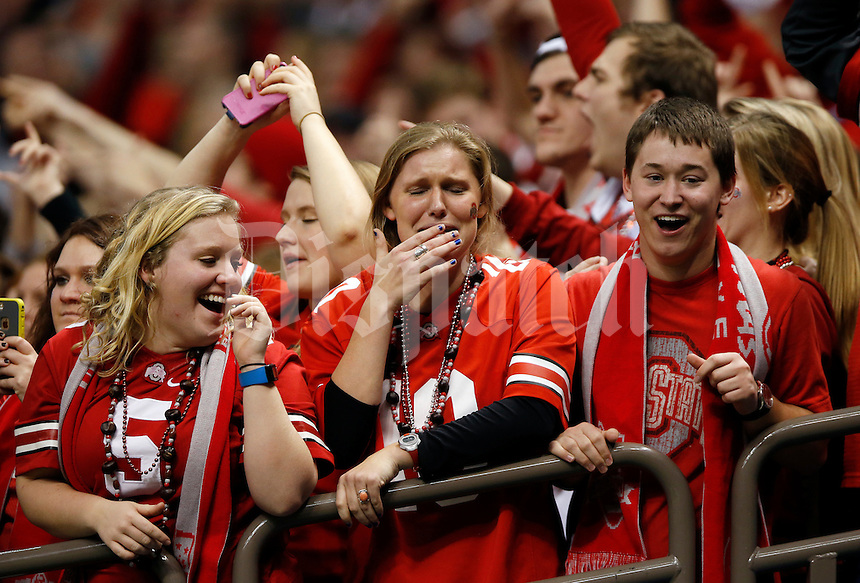 Ohio State fans react in disbelief after an 85-yard touchdown by Ohio State Buckeyes running back Ezekiel Elliott (15) during the fourth quarter of Ohio State's win over Alabama in the Allstate Sugar Bowl college football playoff semifinal at the Mercedes-Benz Superdome in New Orleans on Jan. 1, 2015. (Adam Cairns / The Columbus Dispatch)
