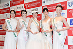 Junna Yamagata, center, 21-year-old college student, poses for photos after winning the Miss International Japan 2016 in Tokyo on November 4, 2015. (Photo by AFLO)