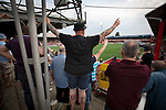 A home supporter with a tattoo of the club's crest standing on the Ealing Road terrace as Brentford hosted Leeds United in an EFL Championship match at Griffin Park. Formed in 1889, Brentford have played their home games at Griffin Park since 1904, but are moving to a new purpose-built stadium nearby. The home team won this match by 2-0 watched by a crowd of 11,580.