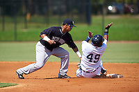 GCL Yankees 1 second baseman Bryan Cuevas (53) swipes the tag as Adrian Alfaro (49) slides in during the first game of a doubleheader against the GCL Tigers on August 5, 2015 at Tigertown in Lakeland, Florida.  GCL Tigers derated the GCL Yankees 5-2.  (Mike Janes/Four Seam Images)