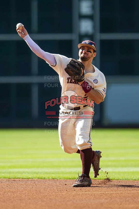 Texas A&M Aggies second baseman Ryne Birk (2) makes a throw to first base during Houston College Classic against the Nebraska Cornhuskers on March 6, 2015 at Minute Maid Park in Houston, Texas. Texas A&M defeated Nebraska 2-1. (Andrew Woolley/Four Seam Images)