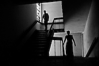 Two patients are seen walking up a stairwell at the Rajan Babu TB hospital in New Delhi, India.