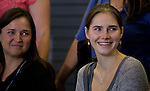 Amanda Knox, right, and her mother Edda smile at a crowd of supporters during a news conference held  at the Seattle-Tacoma International Airport near Seattle, Washington on October 4, 2011. Knox arrived in the United States after departing Rome's Leonardo da Vinci airport,. Knox's life turned around dramatically Monday when an Italian appeals court threw out her conviction in the sexual assault and fatal stabbing of her British roommate.  ©2011. Jim Bryant Photo. All Rights Reserved.