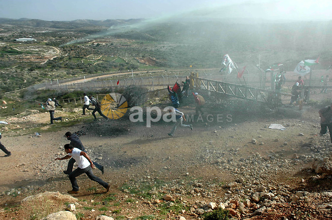 Israeli patrol spread waste water at Palestinian demonstrators during a demonstration on the sixth anniversary of the construction of the wall in Bil'in village  in the West Bank city of Ramallah November 19, 2010 . Photo by Nedal Shtieh
