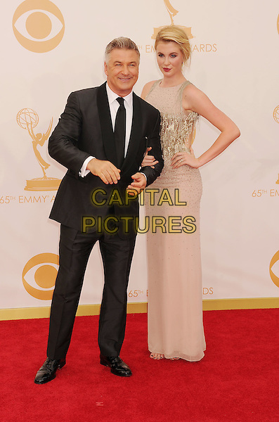 Alec Baldwin, Ireland Baldwin<br /> arrives at the 65th Annual Primetime Emmy Awards at Nokia Theatre L.A. Live in Los Angeles, California, USA, <br /> September 22nd 2013. <br /> emmys arrivals full length father dad daughter family black suit tie white shirt beige nude dress long maxi hand on hip gold beaded sequined sequin sleeveless <br /> CAP/ROT/TM<br /> &copy;TM/Roth Stock/Capital Pictures