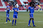 Nathan Arnold, Craig Clay and Jon-Paul Pittman of Grimsby Town wear supporters' wigs after the Vanamara Conference League match between Woking and Grimsby Town at the Kingfield Stadium, Woking, Surrey<br /> Picture by David Horn/eXtreme aperture photography +44 7545 970036<br /> 07/03/2015